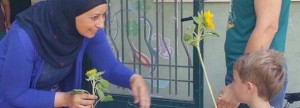 Hand in Hand teacher student flower Israel 2016 website